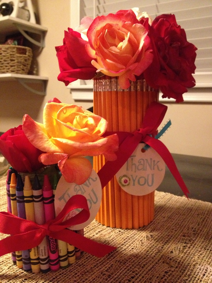Teacher gift. Pencil & crayon vases. I used a Snapple bottle for pencils and tall baby food jar for crayons. Secure with rubber band, hot glue around the bottom, cover rubber band with ribbon.