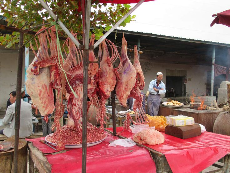 This open air restaurant at the Sunday livestock market in a suburb northwest of Kashgar, Xinjiang, China, has a ready supply of meat.