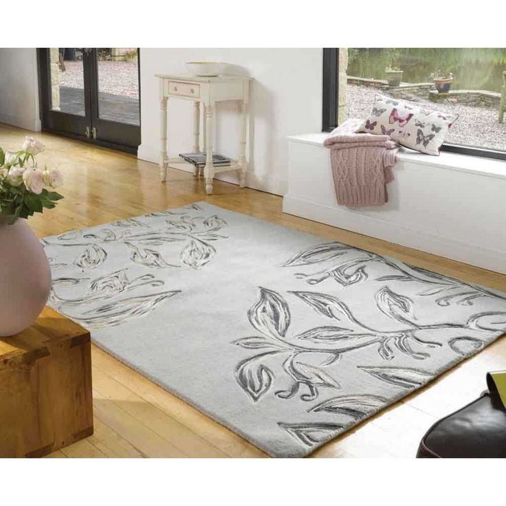 Amazing modern floral designs with a unique subtle touch it. This Textures Florali Slate Wool Rug will be a classy addition to your décor. #woolrugs #luxuriousrugs #floralrugs #handmaderugs #greyrugs