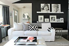 accent wall with paint, shelves, and frames