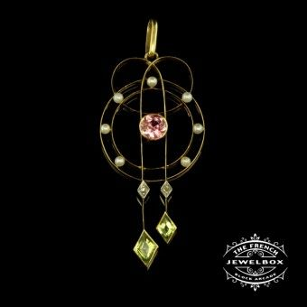 Edwardian Suffragette Pendant Representing women's right to vote, this 18ct yellow gold pendant has pink tourmaline, peridots, pearls and diamond, circa 1905.