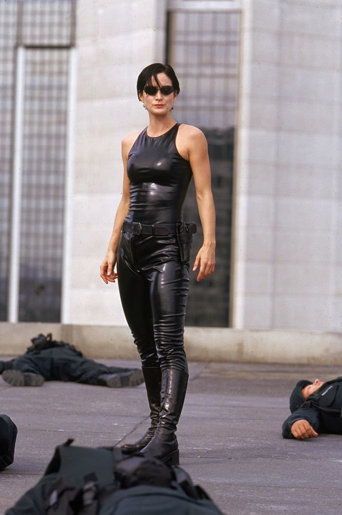 The Matrix. (Costume designer Kym Barrett). Great use of material to absorb  and reflect light.   Carrie anne moss, The matrix movie, Movies