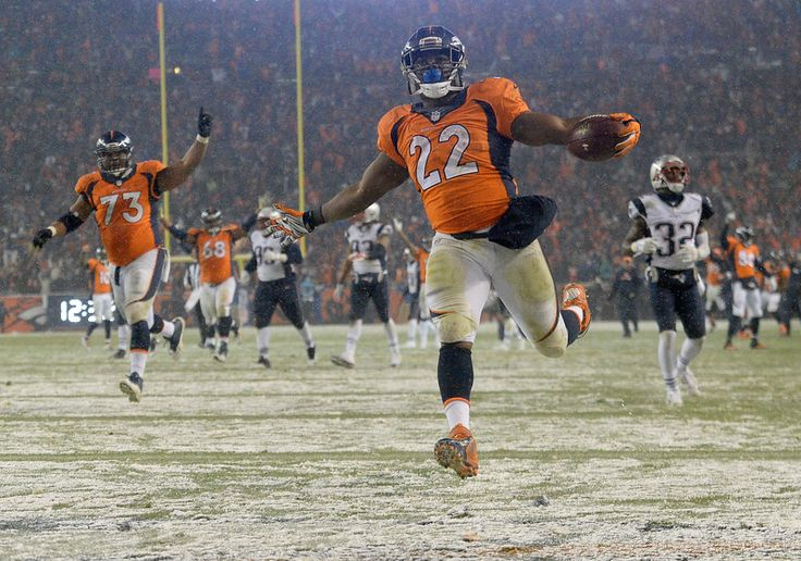 WOOT! WOOT!   C.J. Anderson (22) of the Denver Broncos scores the game-winning touchdown in overtime. The Broncos played the New England Patriots at Sports Authority Field at Mile High in Denver, CO on November 29, 2015.