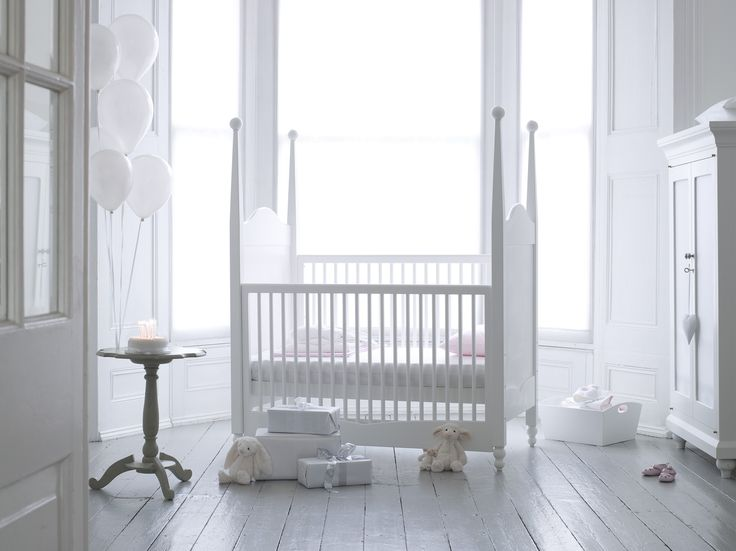 Meticulously hand-crafted from solid wood and laminated birch and finished in a durable child-safe white lacquer, the Hestia four-poster cot bed can be transformed from a cot to a toddler bed and then to a day-bed. With beautifully shaped feet and elegant turned spheres adorning each tapered post, the Hestia Cot lends a sense of regal elegance to your child's nursery.  www.Bambizi.co.uk