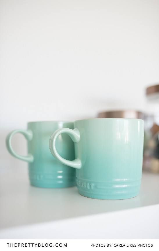 Chic, minimalist workspace with turqoise mugs | Photo by Carla Likes Photos