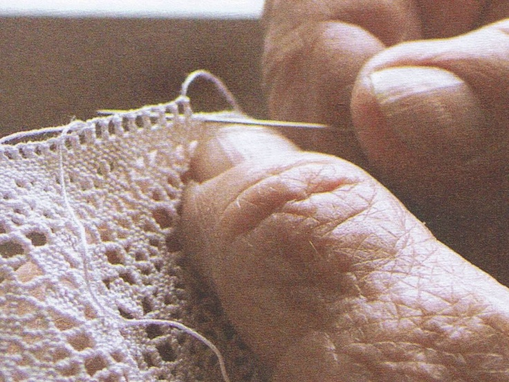 making puncetto, a needle and some thread