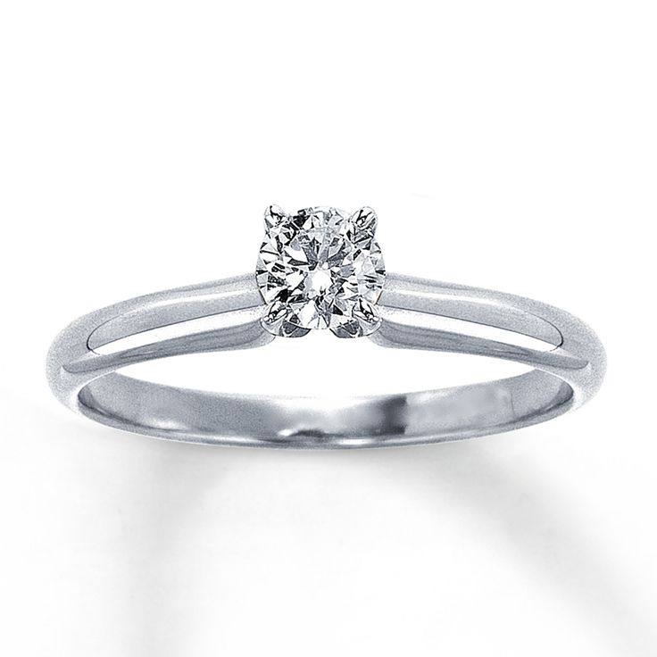 This 1/3 carat diamond is beautifully displayed in a prong setting mounted on a 14K white gold band in this lovely engagement ring. Diamond Total Carat Weight may range from .29 - .36 carats.