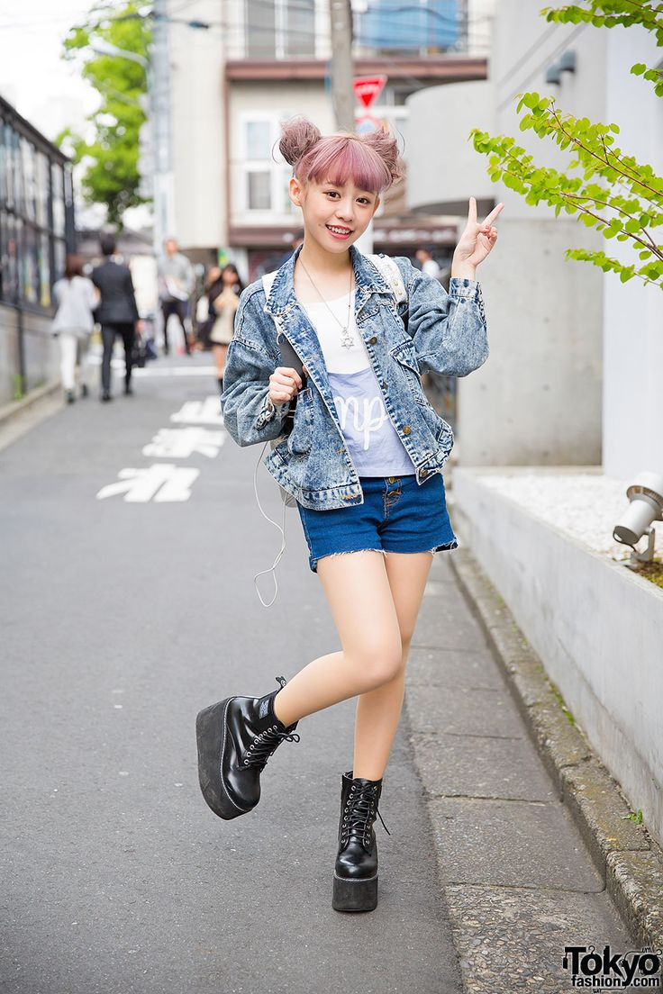 Taiwanese model Kimi on the street in Harajuku with a lilac twin buns hairstyle, denim jacket, cutoffs, and platform shoes.