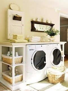 A pair of matching bookshelves with a tabletop or slab of laminate countertop creates a full-service laundry center. If needed, screw decorative feet into the bookcase to ensure that they're about half an inch taller than your appliances.