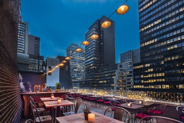 The Roger Smith Hotel features two of the best hotel bars in NYC: Henry's Rooftop Bar and Lily's Bar & Lounge. Both are perfect for a drink in Midtown.