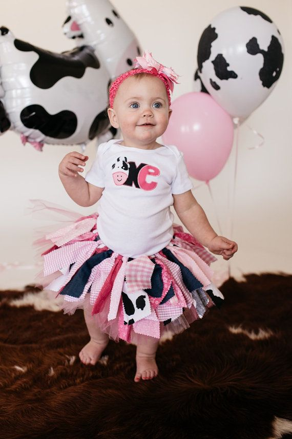 This barnyard inspired outfit includes a double layer fabric and tulle tutu in shades of pink along with cow print, a personalized top with sewn on one with cow, plus a matching hair accessory in coordinating ribbon. Need a different number? Message us to discuss options. :)  **** COPY AND PASTE this information(filled out) in your notes to seller box at checkout: Date Needed:  Childs Name(if applicable):  Age (if applicable):  Include Crochet Headband (y/n): Special design requests:  If you…