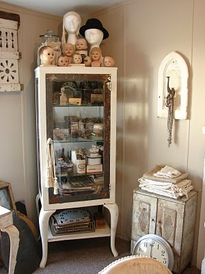 old medical cabinets are so awesome but the collection of baby heads is