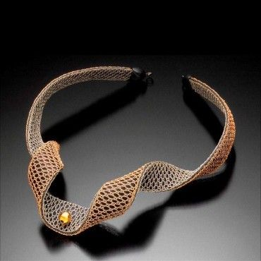 Necklace | Lauran Sundin. Lauran weaves using 14k to 22k gold and sterling silver wire.
