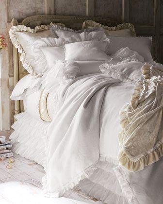 Dreamy white ruffled bed