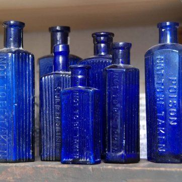 "Antique blue poison bottles with inscription ""Not To Be Taken"" or ""Poison""                               ****"
