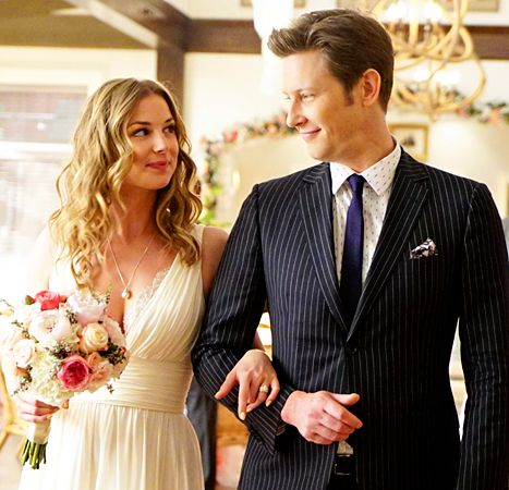 Amanda Clarke (Emily VanCamp) gets walked down the aisle by Nolan Ross (Gabriel Mann) in the Revenge finale.