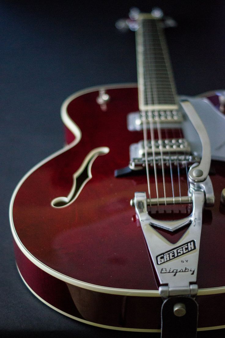 guitar-porn:   Bigsby on a 90s Gretsch Tennessee Rose. Here's a beauty of a shot taken byChris Curnutt, just one of those guitars that could make you stop short mid-sentence andstare for a very long time.