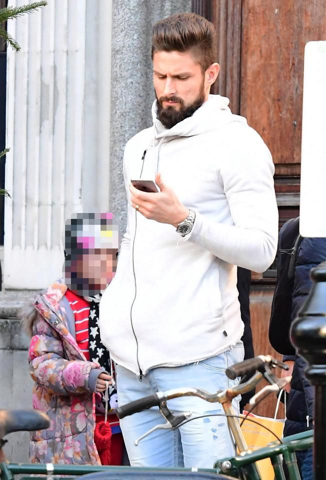 Olivier Giroud found a quiet moment in North London to check another replay of his stunning scorpion kick goal against Crystal Palace