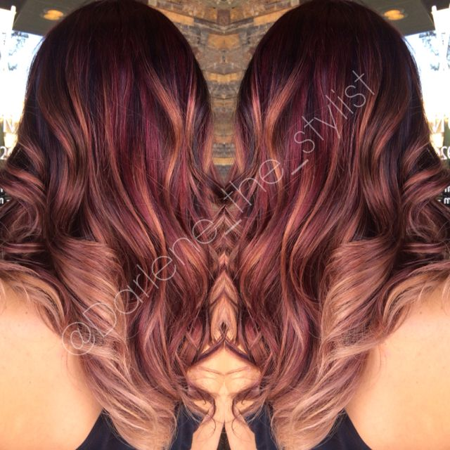Rich warm balayage with a red base, lowlights, and subtle blonde ombré balayage to give it lots of dimension!