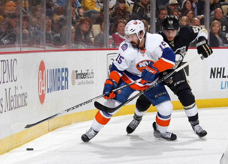 54ce1865f ... Jersey Home Royal Blue Islanders - - Cal Clutterbuck of the New York  Islanders tries to control the puck in ...