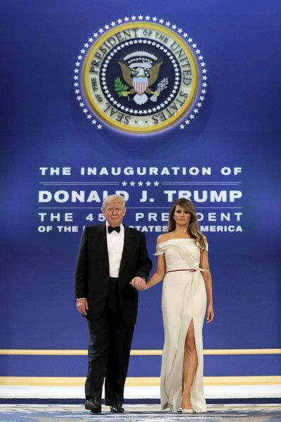 Melania Trump Photos Photos - U.S. President Donald Trump (L) and first lady Melania Trump arrive at the Armed Forces Ball at the National Building Museum January 20, 2017 in Washington, DC. The ball is part of the celebrations following Trump's inauguration. - President Donald Trump Attends A Salute To Our Armed Services Ball