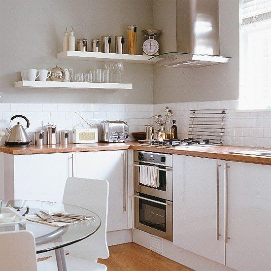 A look a bit like this - chunky wooden worktop, clean white doors, long handles, chunky white shelves by back door.