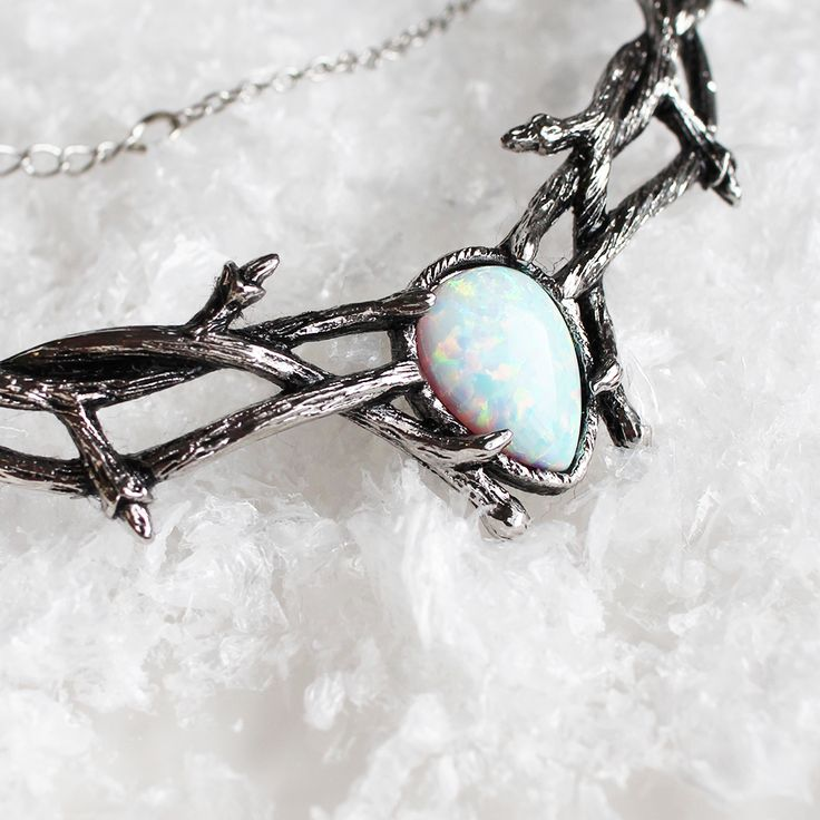 The beautiful Skadi, an enchanting snow opal choker featuring delicate thorn detailing for a Gothic touch. ✧✧ Shop the treasures from our Ice Queen's trove at www.shopdixi.com ✧✧ // shopdixi // icequeen // shop dixi // boho // bohemian // winter // ice // hippie // jewellery // jewelry // giftideas // bohochic // winter // ice // snow // moonstone