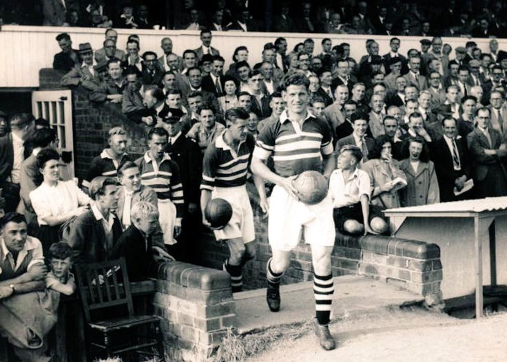 Northampton Town captain Tim McCoy leads the team out in 1949
