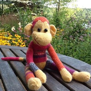 Sock monkey knit from a pattern designed by Annita Wilschit.