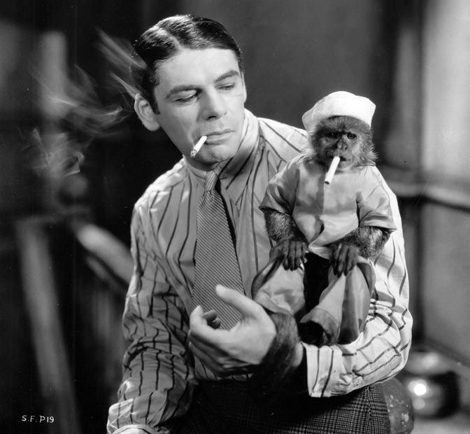 Paul Muni and his little friend in a shot from