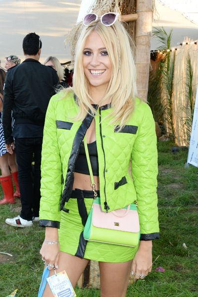 Pixie Lott, V Festival 2014, in neon green quilted mini skirt and jacket, black crop top, neon green and white handbag, purple sunglasses,