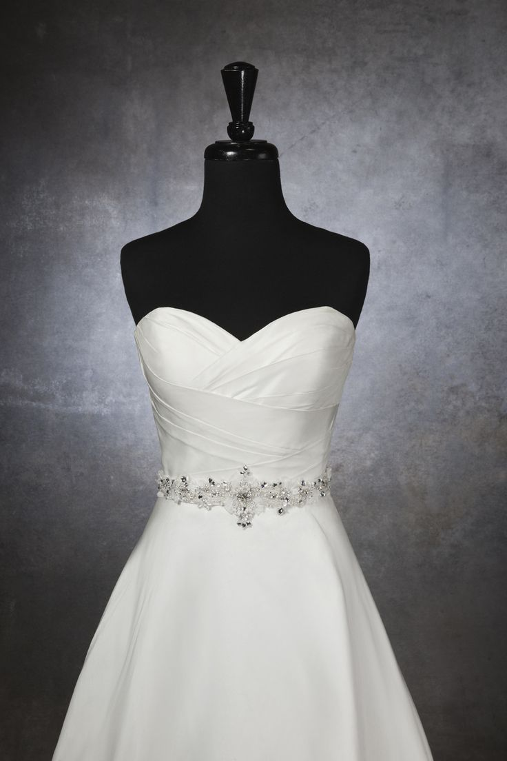 satin self-tie belt with loops of organza ribbons and hand beading done in crystals, bugle beads, and pearls.