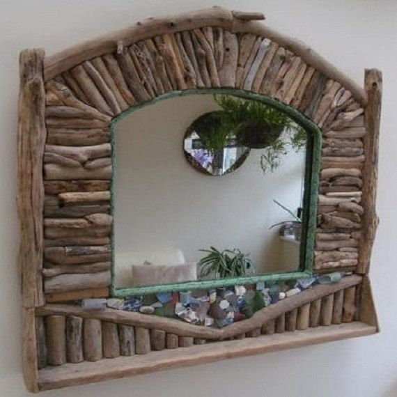 Handmade by seller  This driftwood mirror has been made on ply backer board .All driftwood pieces have been glued & secured to the board. The feature at the front is finished with real beach glass and ceramics. The green rope is trawler net rope all have be found along the foreshores of Dorset. There is also a shelf along the front. Max measurements 850mm x 850mm. Centre mirror is 470mm x 420mm it weighs 18Kg. It has secure fixing on back. All approx. This is a large heavy mirror please m...