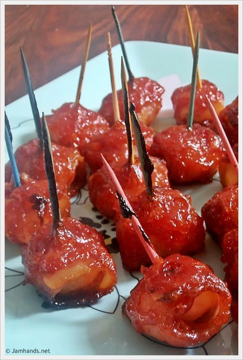 Bacon Wrapped Water Chestnuts (My cousin made these with just water chestnuts, bacon, ketchup, & brown sugar and they are AMAZING!)