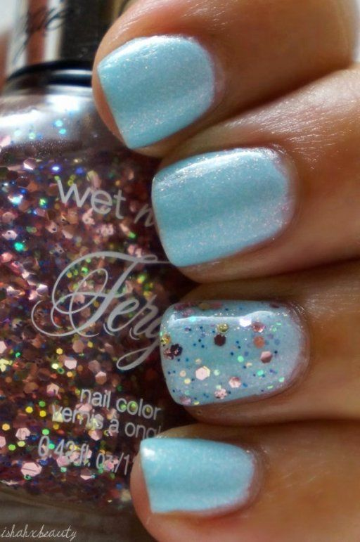 Fergie by Wet n Wild Flossy Flossy, swatched o nail wheel.  Gold, rose gold and tiny blue glitter in a clear base, $3