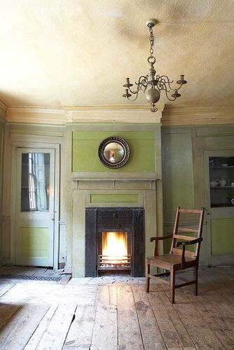 English Georgian interior in East London. Green and gray with cream colored ceilings.