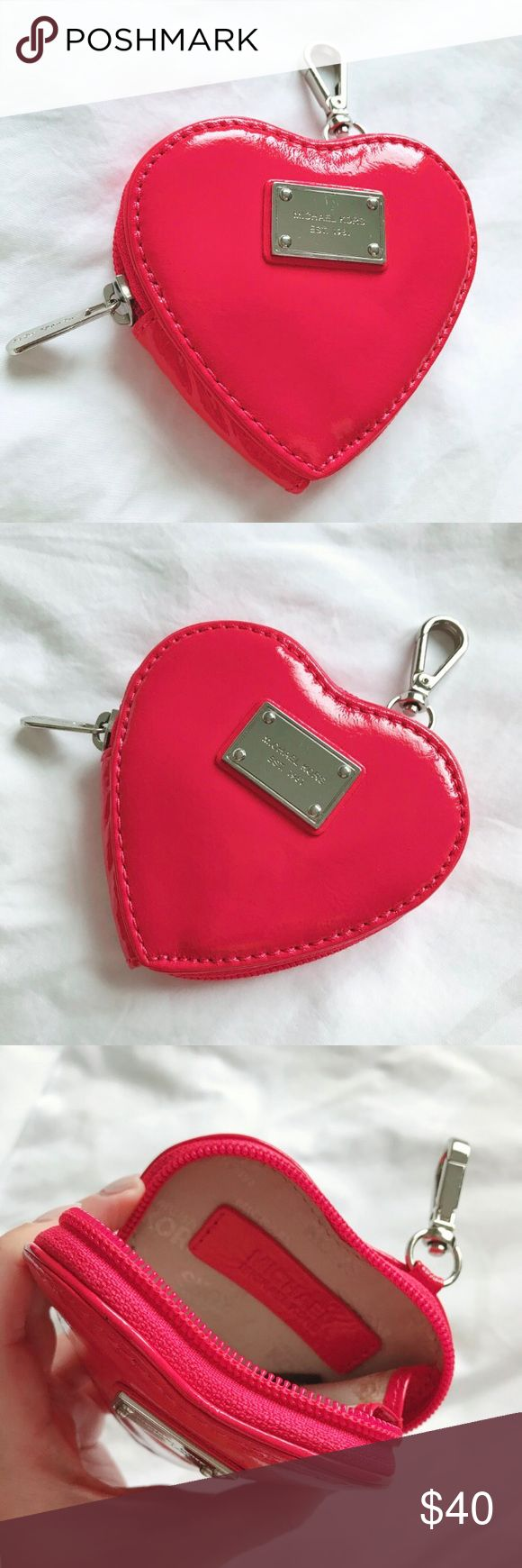 """Michael Kors Red Heart Coin Purse ❤️ Michael Kors Red Patent Leather Heart Coin Purse. Such an adorable style and color! Color is a slightly pink-ish red. Zip Closure that goes almost all the way around makes it easy to access items inside. 4"""" x 3.5"""" x 1"""" Flaws: emblem on front has a few minor scratches, small spot on inside. Otherwise in good condition! :)  ** Sorry, NO trades **  ** Please make offer using """"Offer"""" button ** Michael Kors Bags Clutches & Wristlets"""
