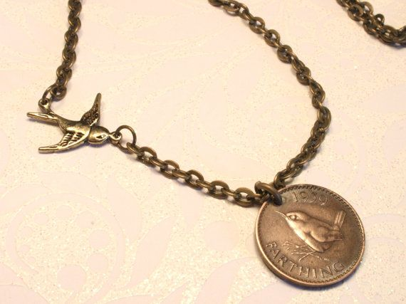 Little bird pendant necklace with old British coin. Farthing with wren and a brass bird on a brass chain.. $25.00, via Etsy.