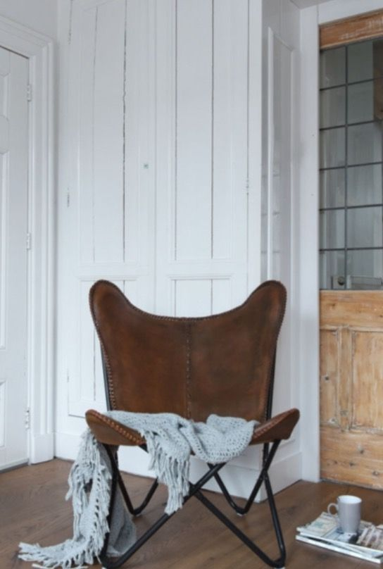 "This lovely leather chair is from our feature ""Family Affair"""