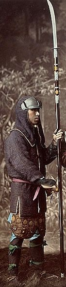 Samurai holding a naginata and wearing a hachi gane (forehead protector) and kusari katabira (chain armor jacket).