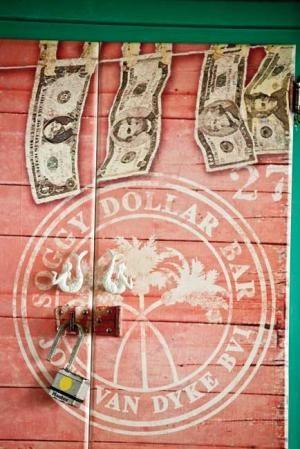 Soggy Dollar Bar Jost Van Dyke, BVI//Jost Van Dyke, familièrement nommée Jost ou JVD, est une île de l'archipel des îles Vierges britanniques. Son nom vient d'un corsaire hollandais, Joost van Dyk. Wikipédia