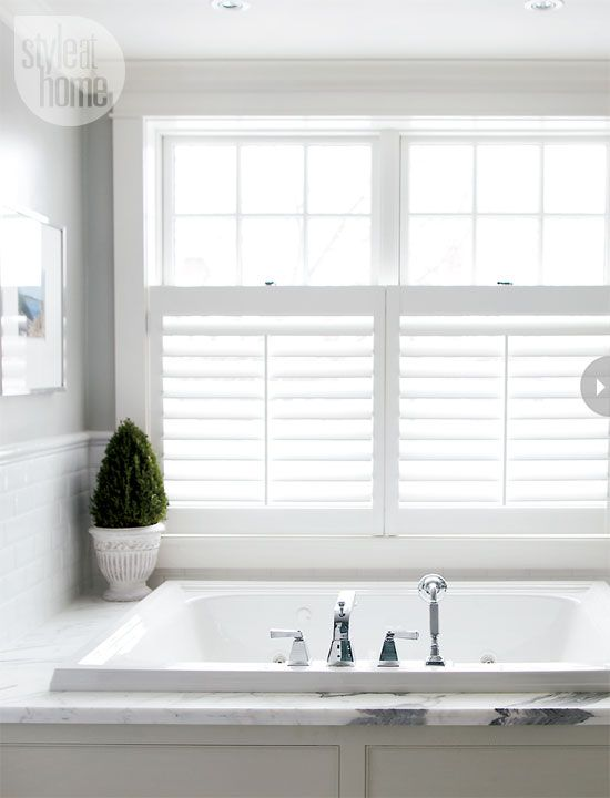 window treatment ~ California shutters over the lower portion