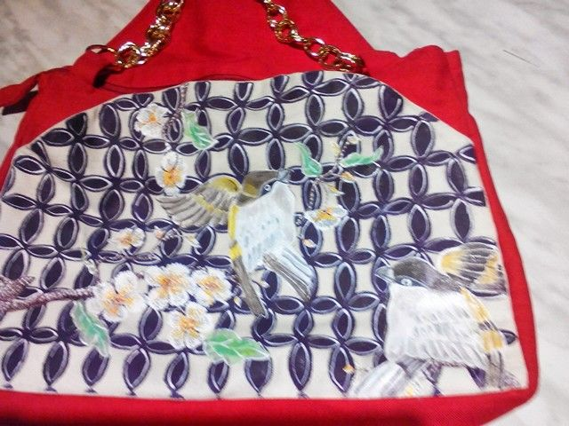 Particular of red shoulder bag handmade and painted by Irene Ferrante