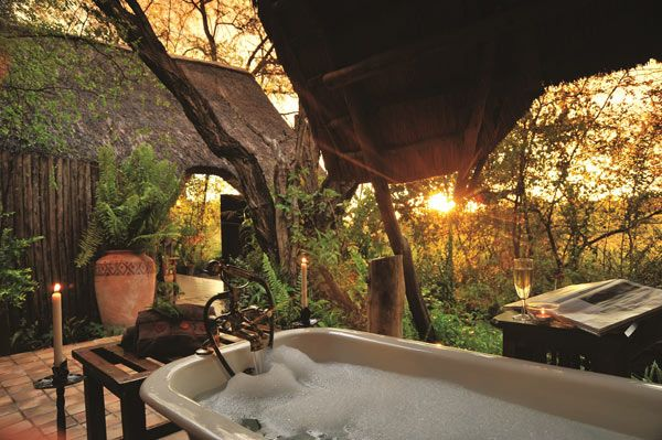 Hide Safari Camp offers only two tented suites with baths that offer views over the wildlife rich waterhole. http://www.uyaphi.com/showcase/best-baths-in-africa.htm