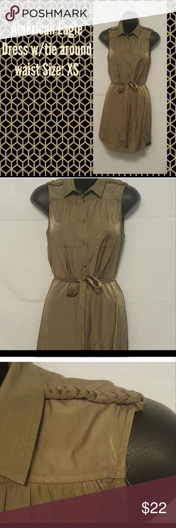 """""""American Eagle"""" Dress w/ tie around waist. This AmericN Eagle Dress is an army green casual button down dress with a tie that wraps the waist showing off a curvy figure and a tiny waist. One of the most unique features are in the shoulders were there are braided bands if the same color stretching from the neck on both sides to the end of shoulders. American Eagle Outfitters Dresses Mini"""