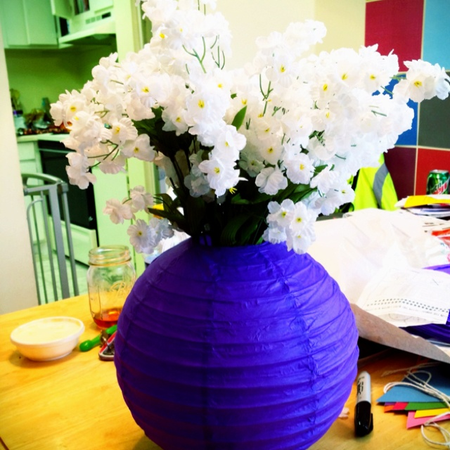 """Casey's Chinese paper lantern vase. I took a 12"""" paper lantern, found a cylinder glass vase to fit in the middle and perfect size to hold lantern tightly open and added these fake flowers :) Real flowers would be lovely but allergies are acting up. All materials from Hobby lobby. I Will be using this for a baby shower centerpiece, each table will have white flowers with a different colored lantern."""