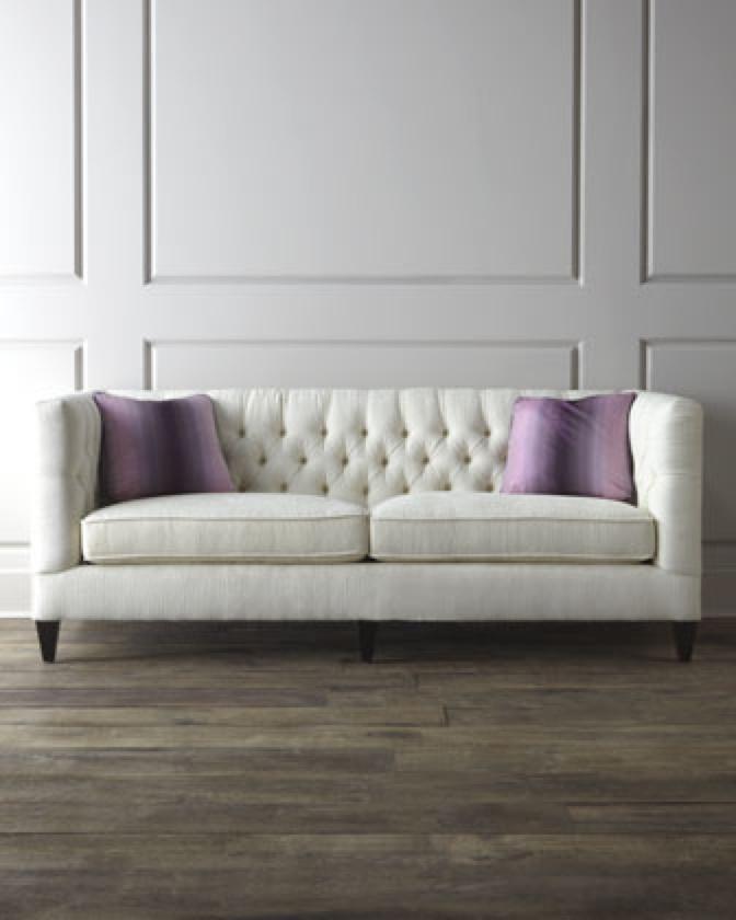 Tufted sofa, interesting wall