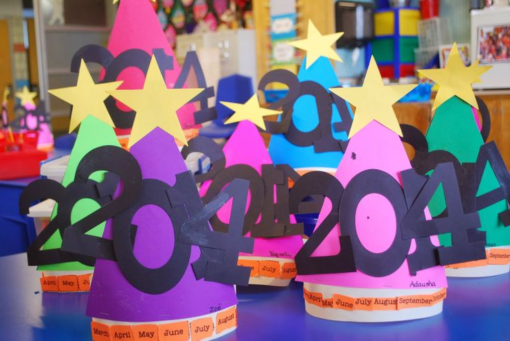 Kinder Kapers: Time....it passes sslowly. Our New Year Hats turned out soooo cute. Month names across the bottom. (freebie file for the names)
