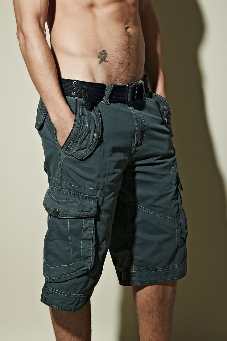 """Men's shorts  Cotton shorts for men  Cargo shorts available in Teal and Army  14"""" inseam; even waist sizes 30-38  Machine wash  Imported  Xray style XMS1041    Adventure is built into the DNA of our Reef men's shorts from Xray. Crisp and casual, these rugged cargo shorts for men feature angled front pockets, cargo pockets and back flap pockets to hold all your essentials. Finished with a webbed grommet belt, cotton Xray shorts come in both classic khaki and colorful teal."""
