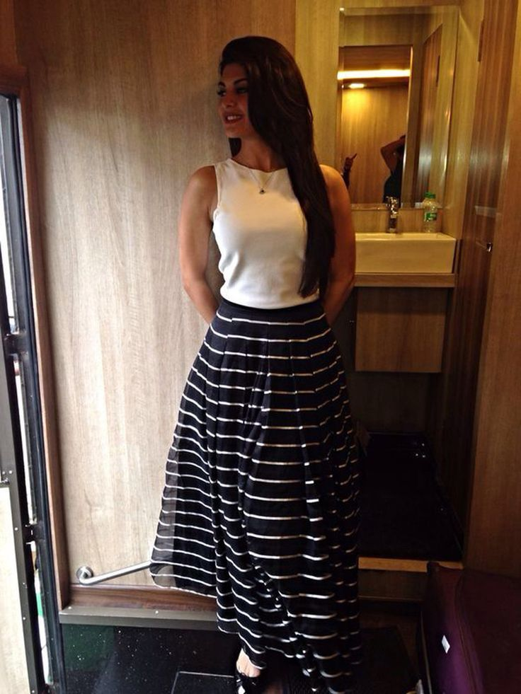 Jacqueline Fernandez dressed in a Giorgio Armani ensemble skirt for  Kick promotions